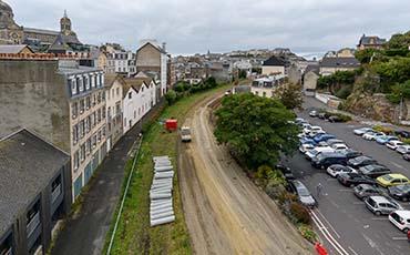Première étape du chantier de la voie douce : le rabotage de la rue du Boscq, crédit: B. Croisy - coll. Ville de Granville